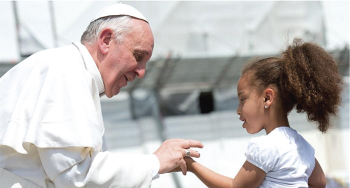 Pope Francis blesses a child. Photo: Catholic Online